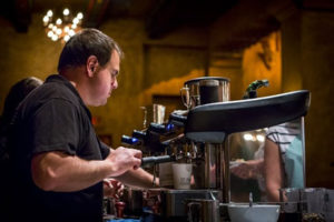 Image of a man brewing